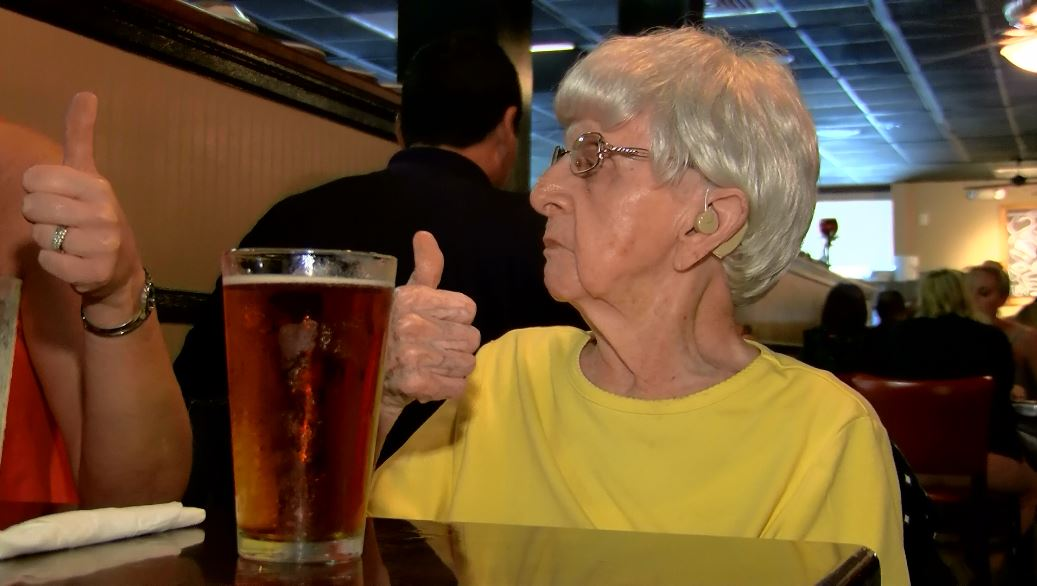 Millie Bowers, who turned 103 recently, gives a thumbs up after having a beer. (Source: Live 5)